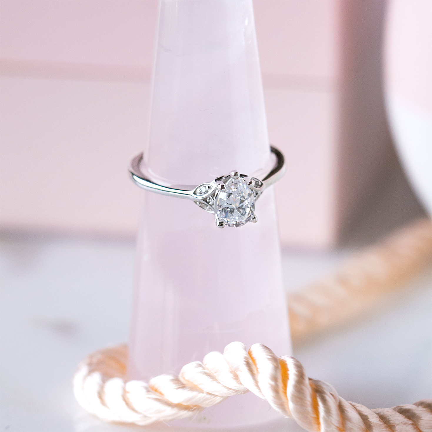 A white gold pear cut engagement ring