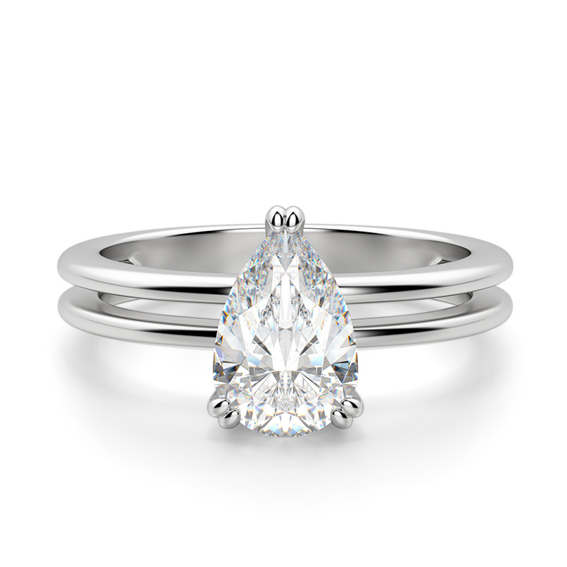 A pear shaped stone in a double band setting
