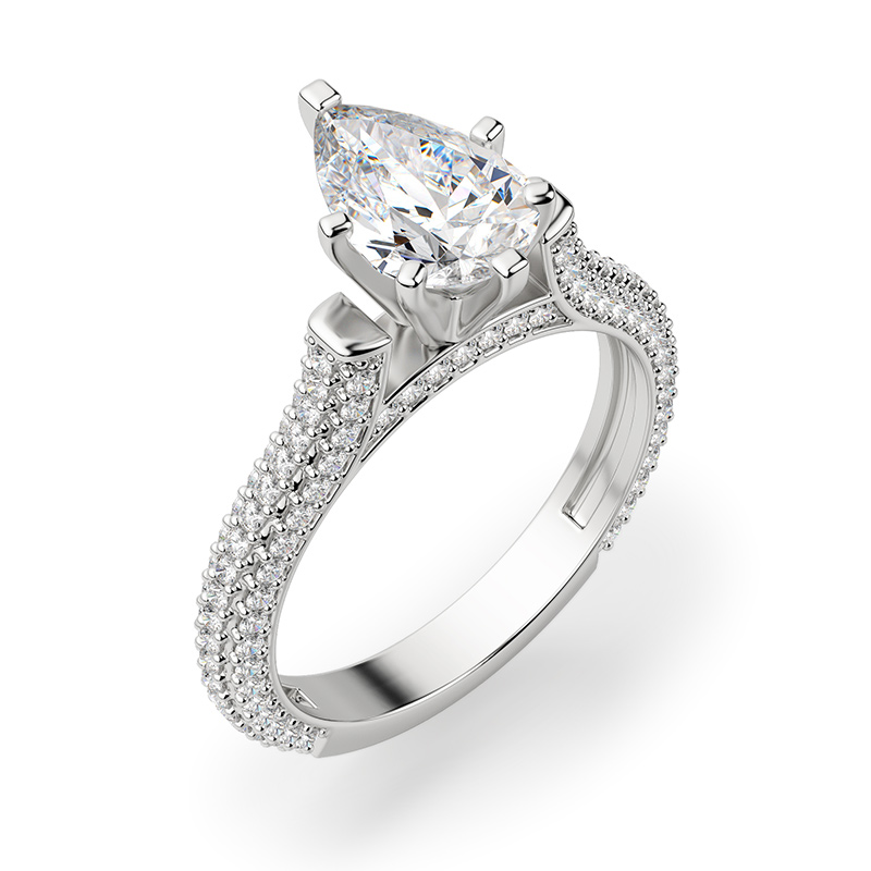 A pear shaped stone in a pave setting