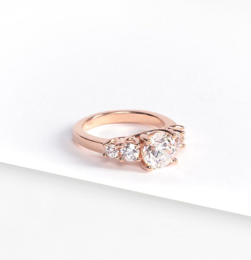 A five stone rose gold engagement ring
