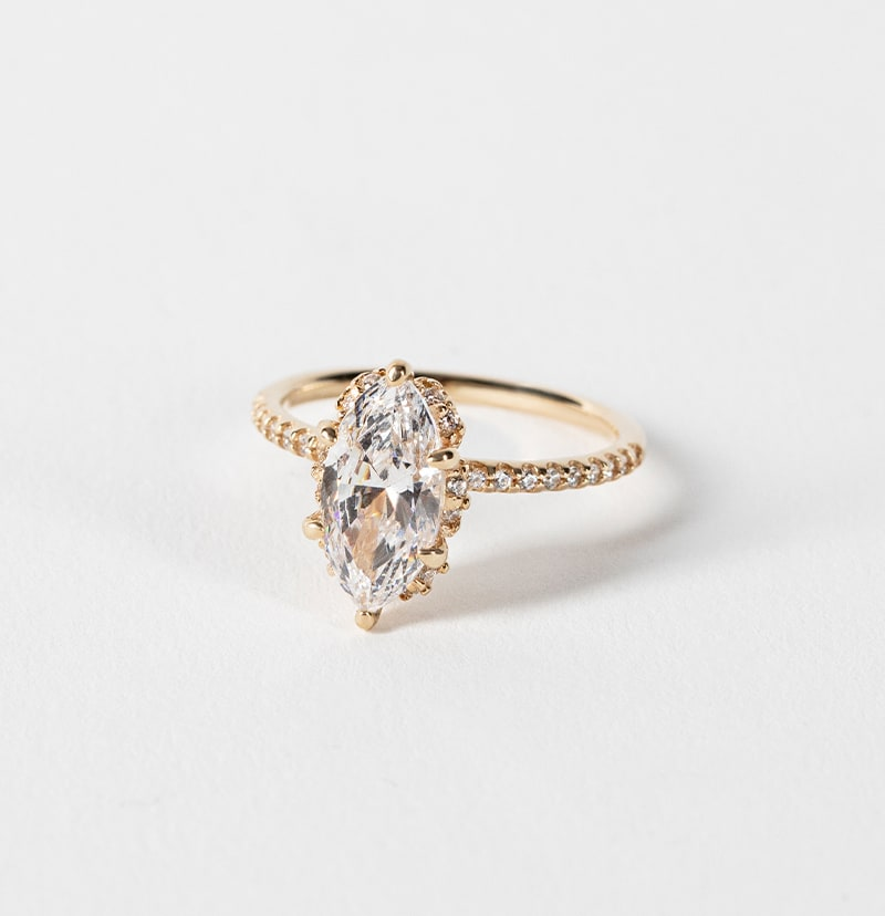 An accented marquise cut engagement ring