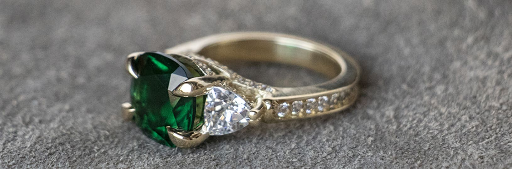 A three stone vintage engagement ring with an accented band