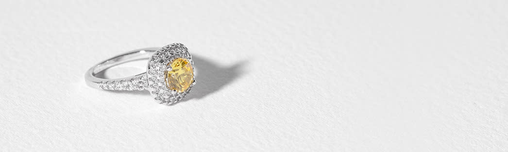 Clearance fashion ring with canary center stone