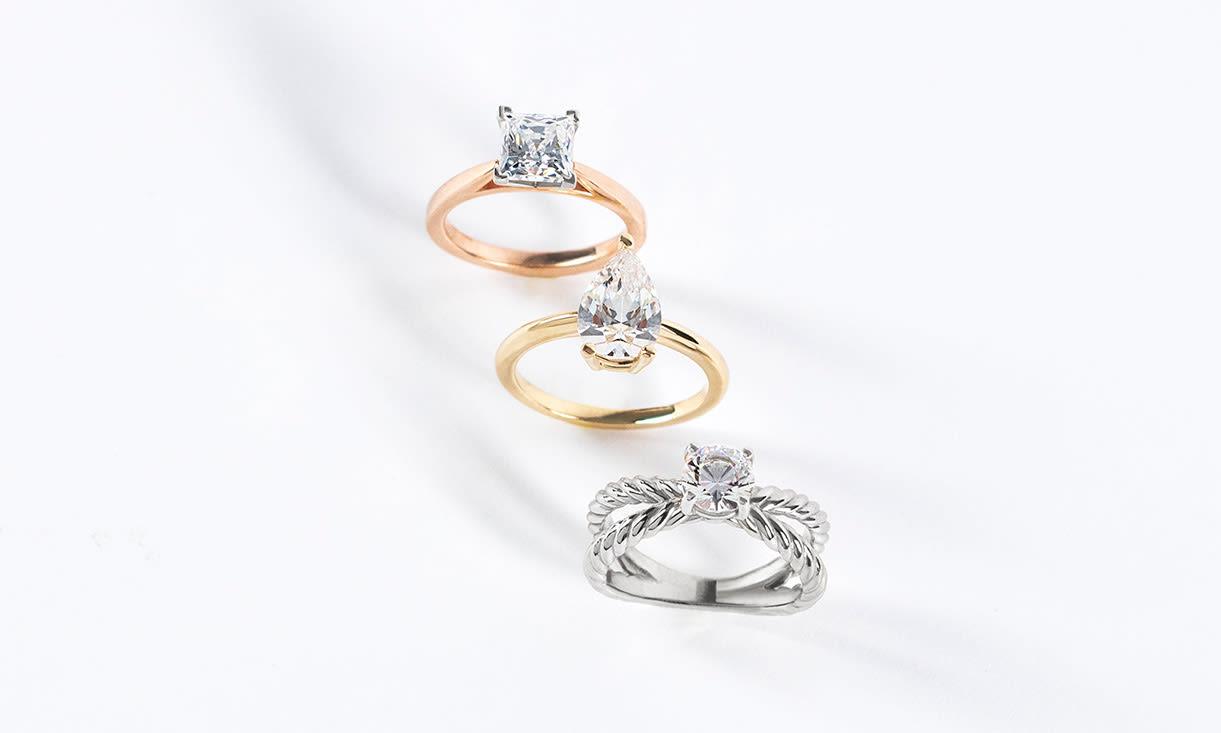 Three Diamond Nexus solitaire engagement rings.