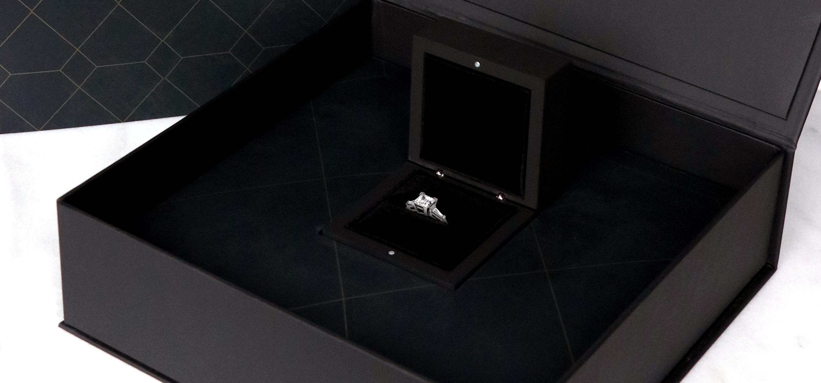 Diamond Nexus engagement ring shown in black, luxury packaging