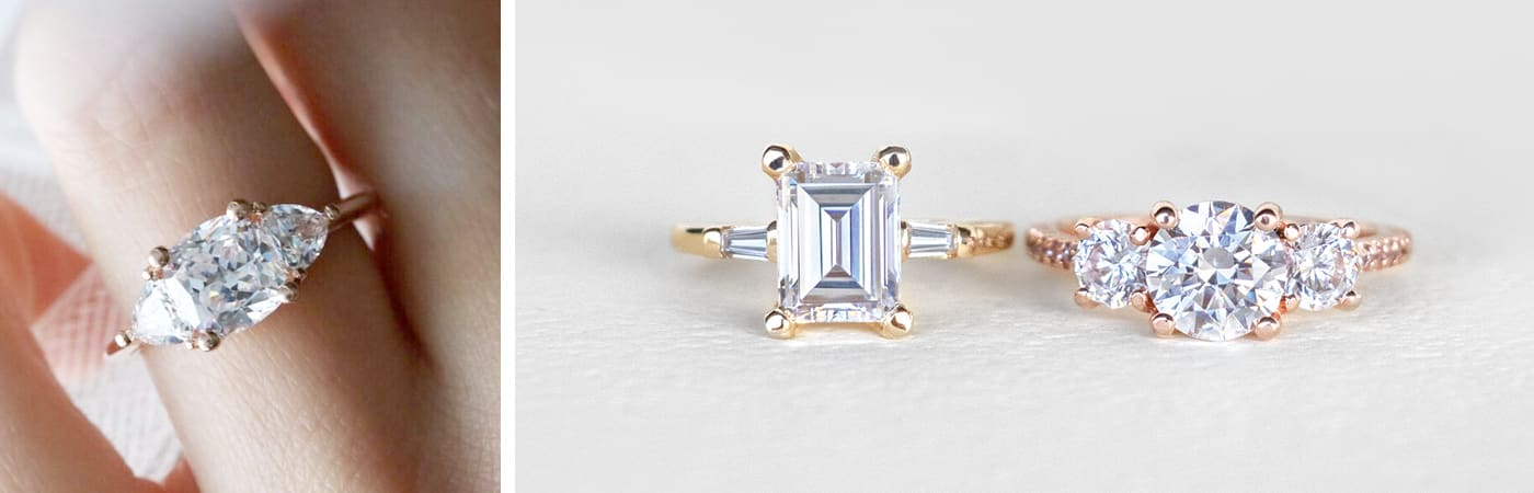 A Diamond Nexus three stone engagement ring with a Marquise center stone. Two modern three stone engagement ring designs featuring Nexus Diamond alternatives.