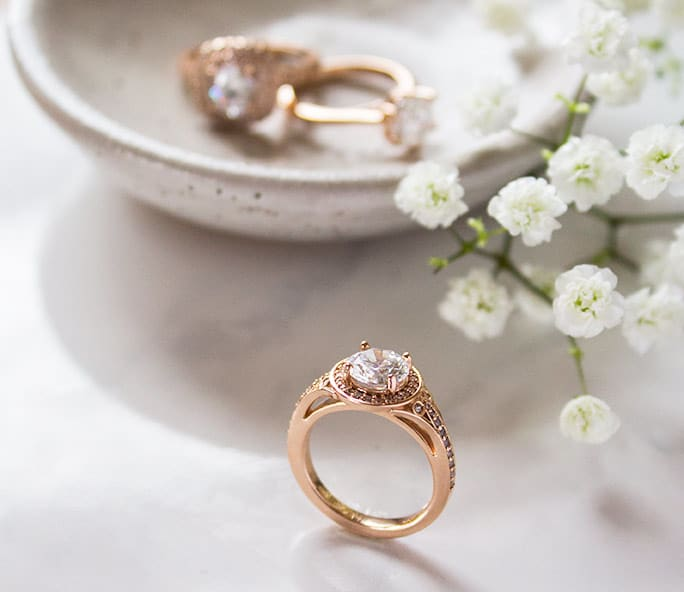 A rose gold halo engagement ring from Diamond Nexus.