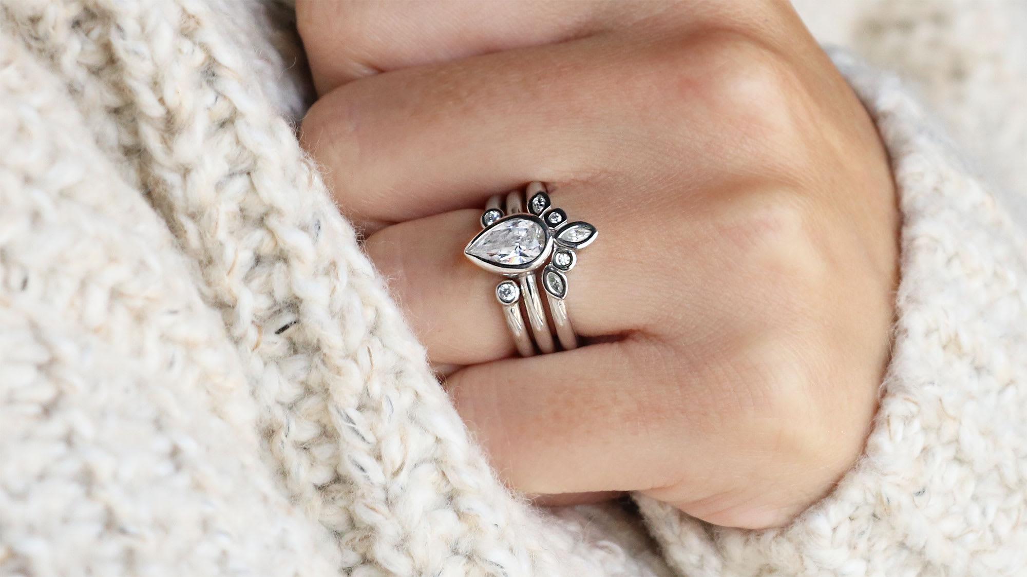 A white gold bezel set wedding ring set from Diamond Nexus.