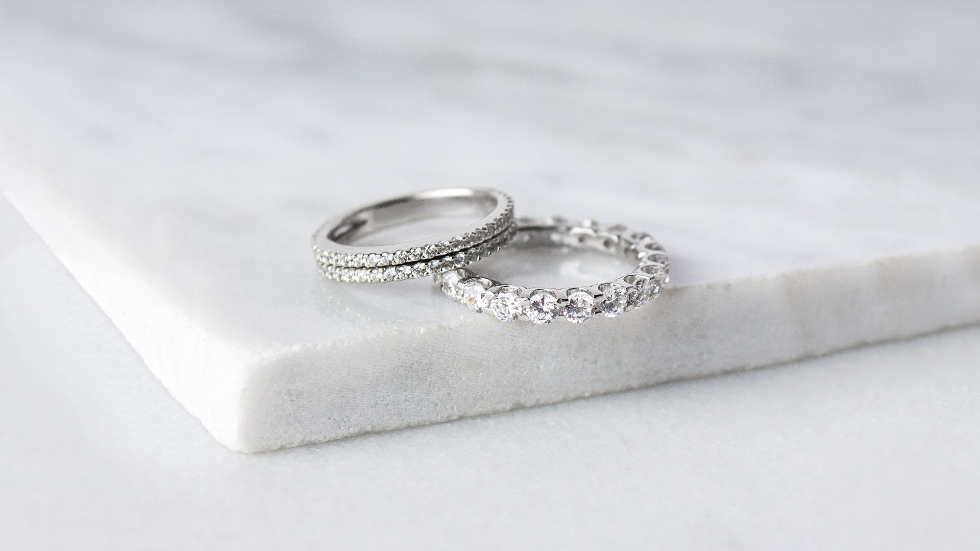 White gold Diamond Nexus wedding bands stacked together.