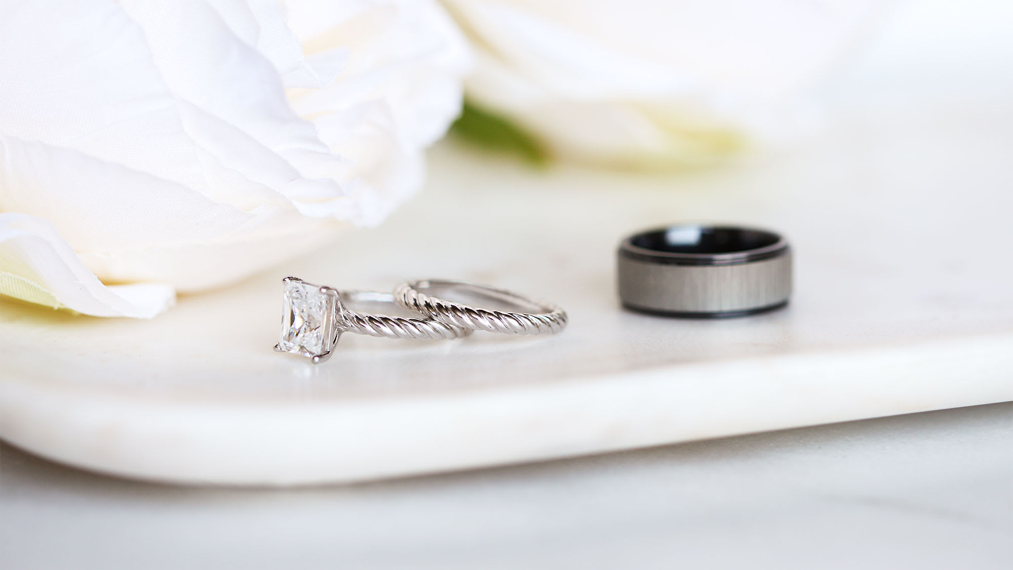 The women's Fiji wedding ring set and men's Levi wedding band.