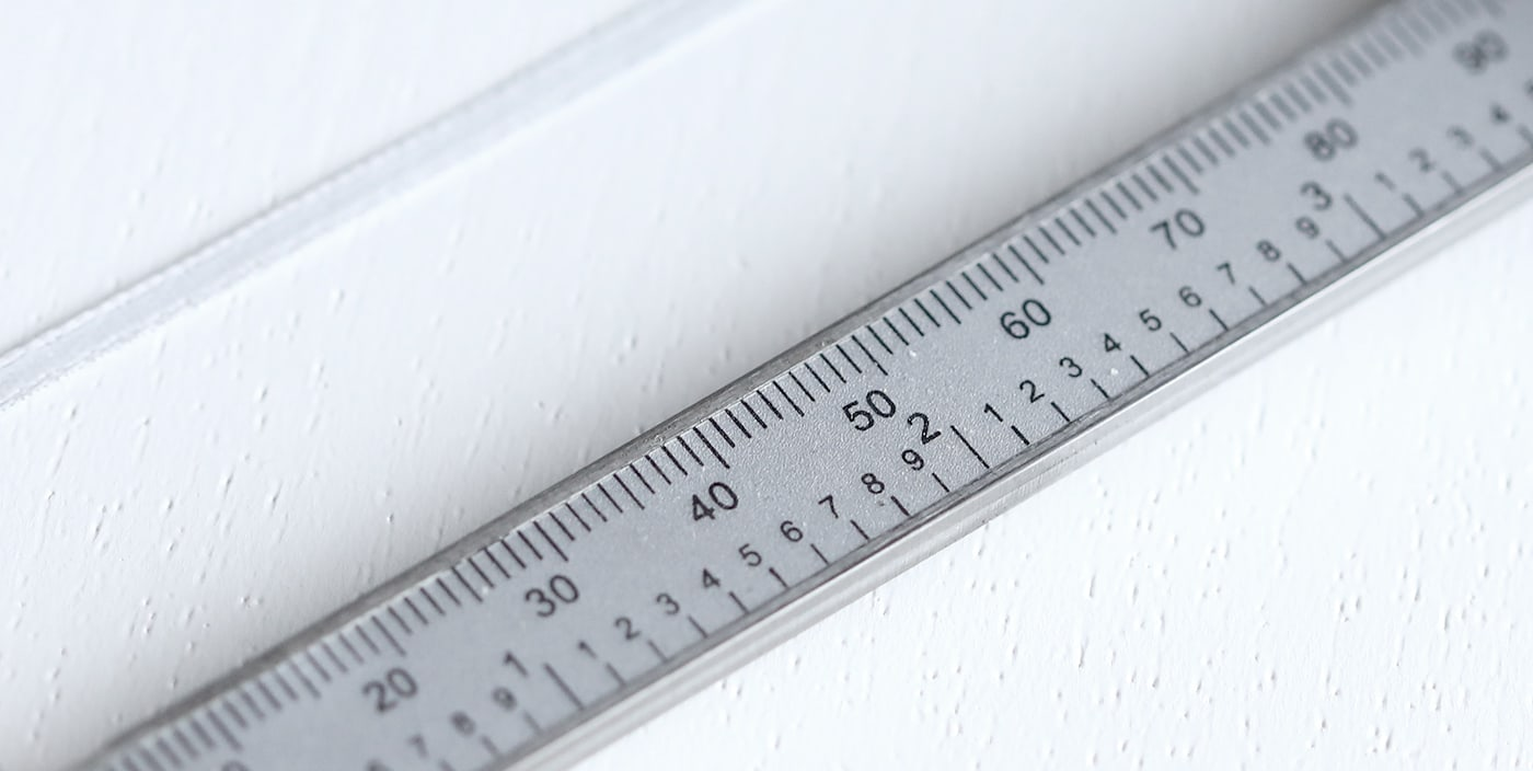 Ribbon placed next to a ruler to determine ring size.