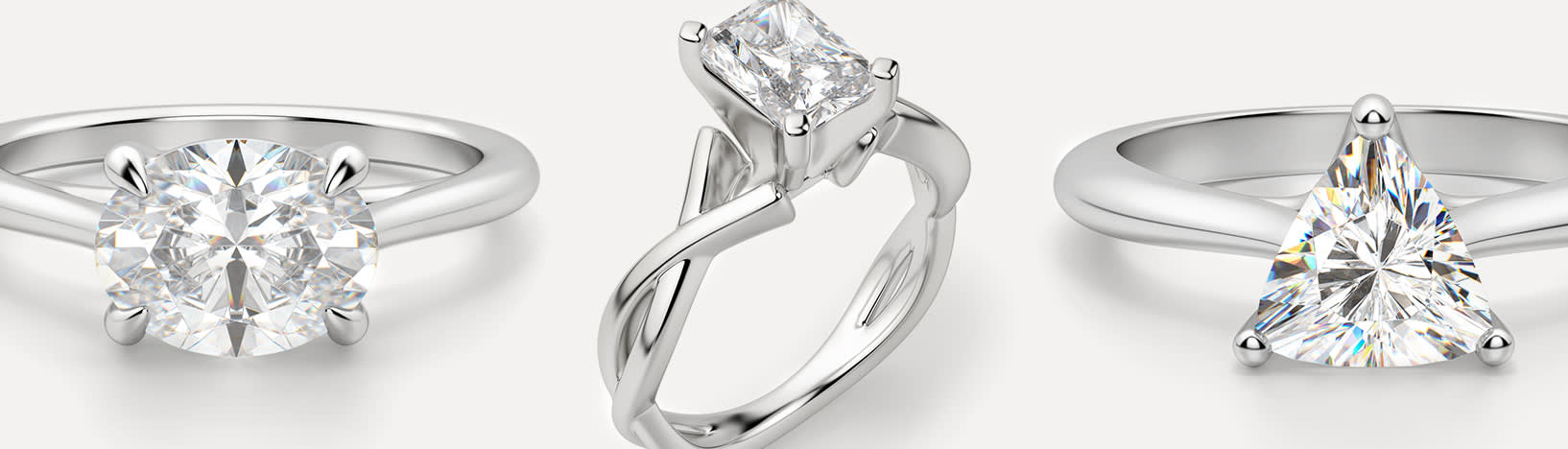 Simulated diamond engagement rings featuring different design elements.