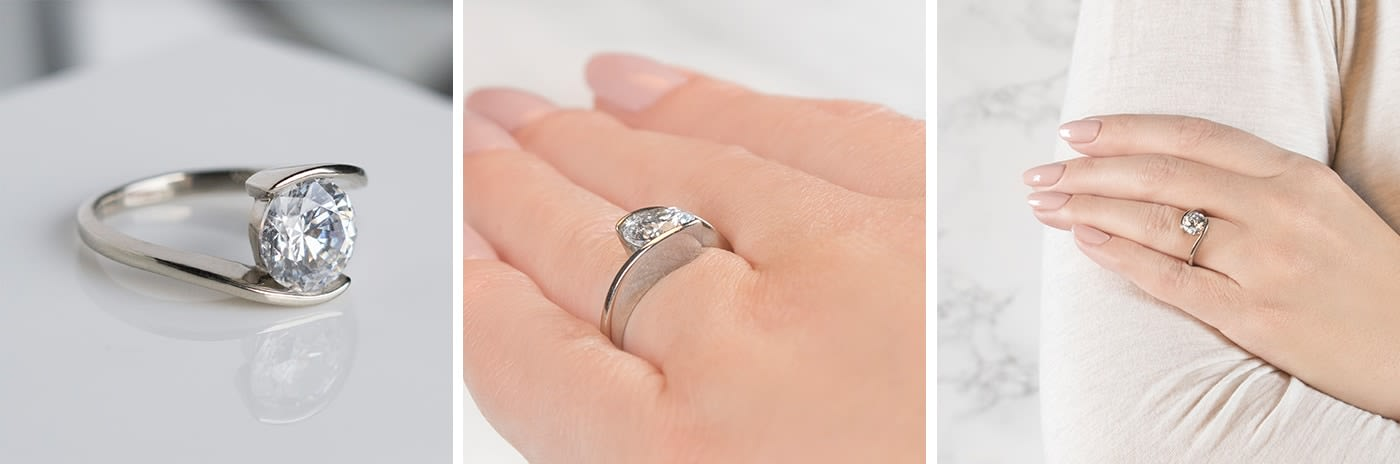 Tension-set simulated diamond engagement ring.
