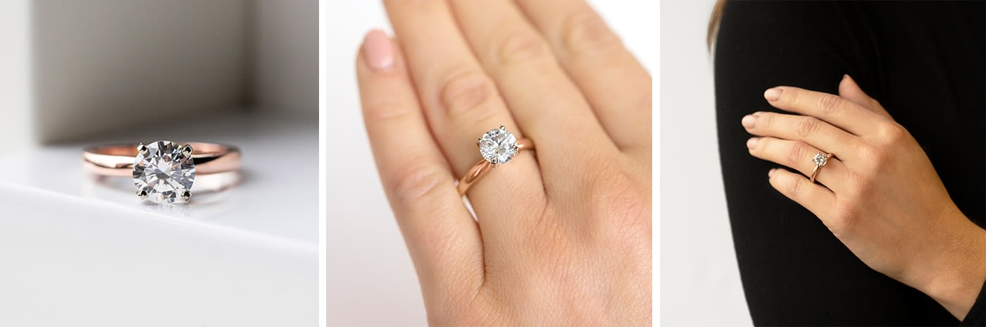 Solitaire prong-set simulated diamond engagement ring.