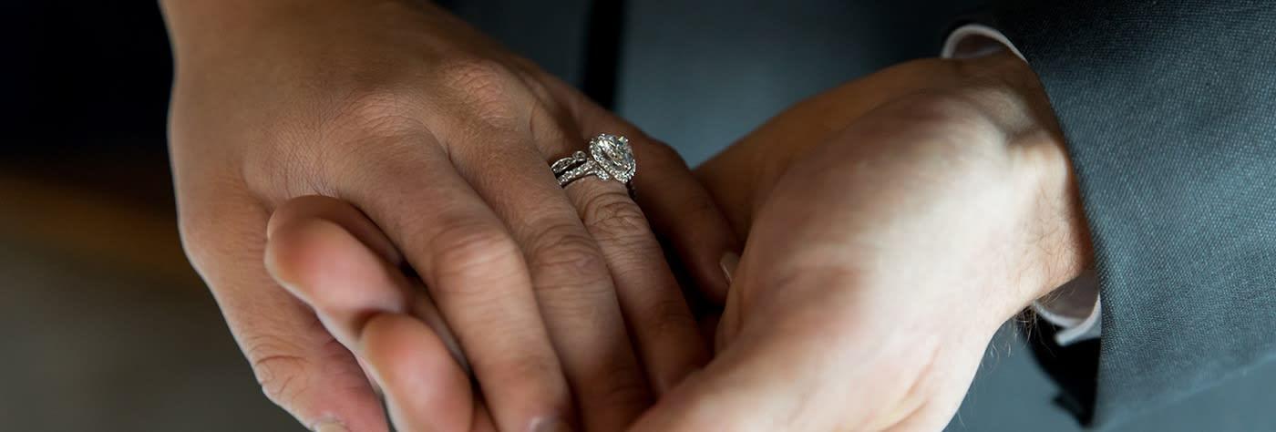 Simulated diamond wedding ring set.