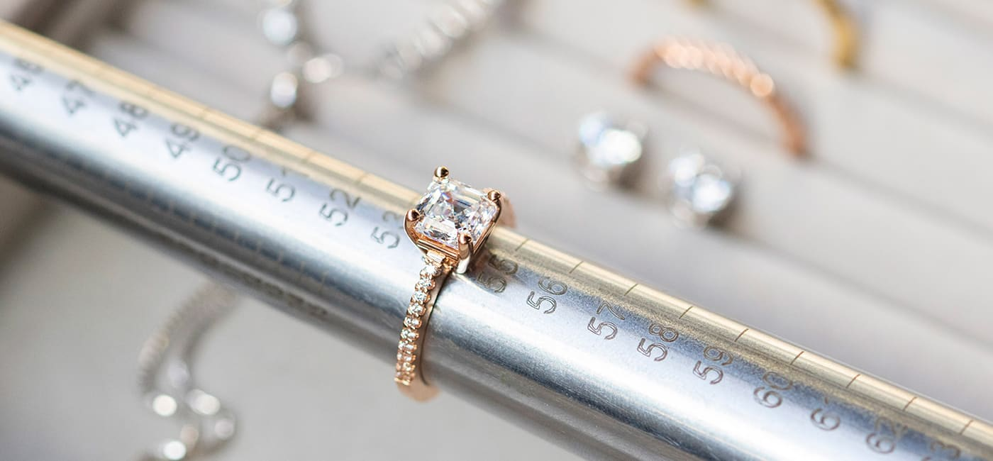 A Diamond Nexus engagement ring being measured on a mandrel