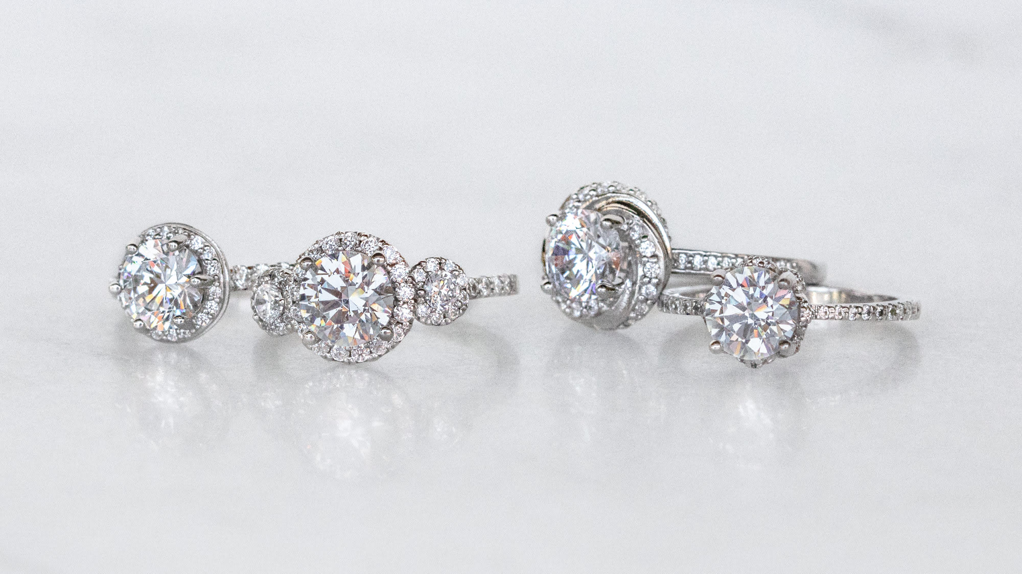 four different halo cut engagement ring options