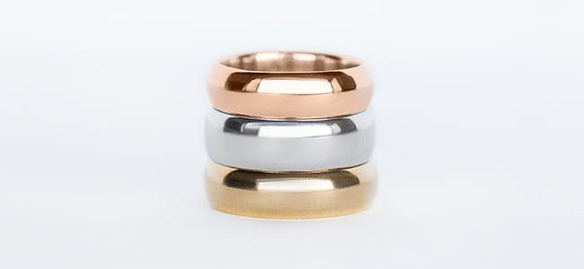 White, yellow and rose gold bands stacked on top of each other.