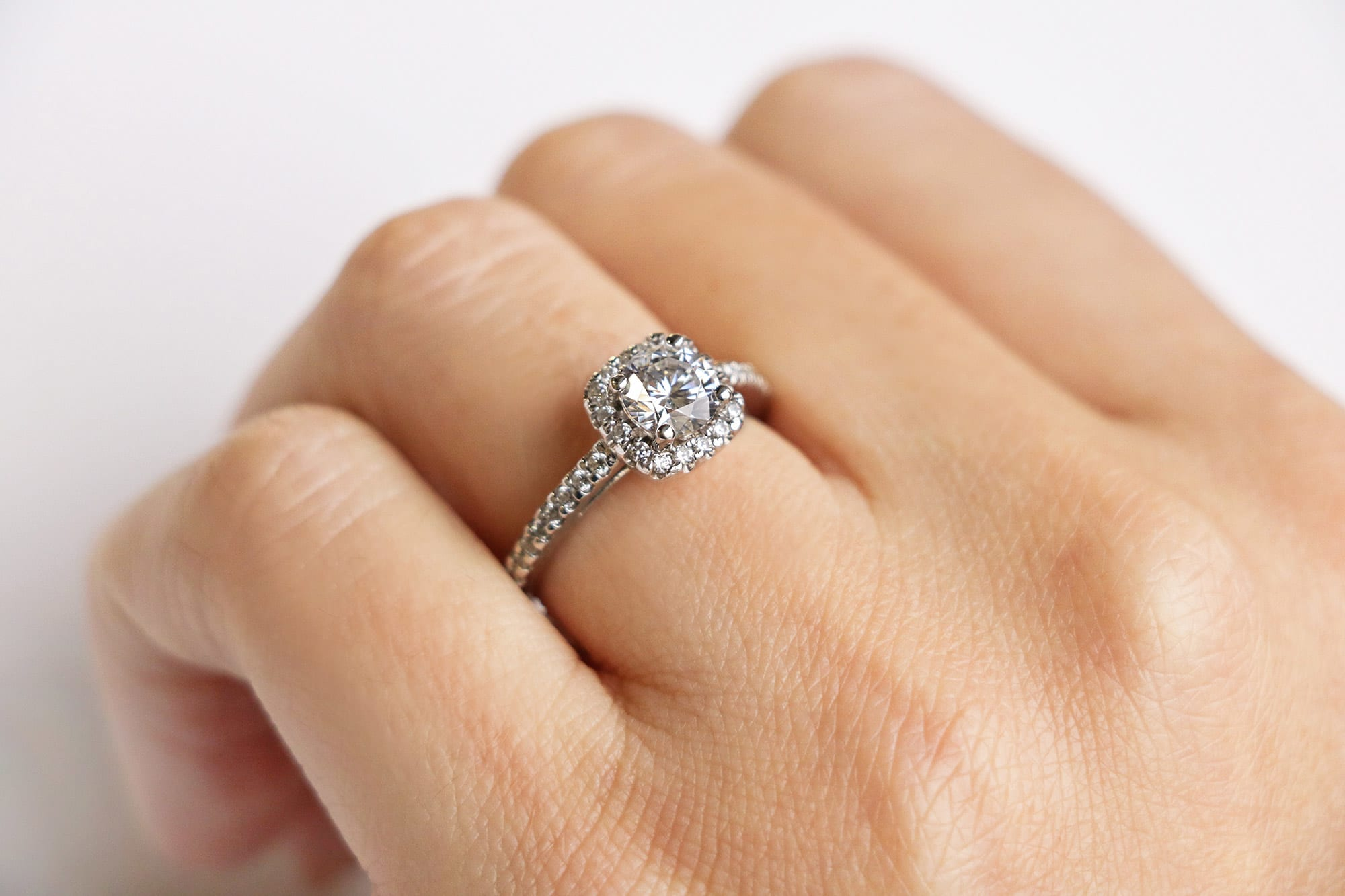 An accented halo engagement ring from Diamond Nexus.