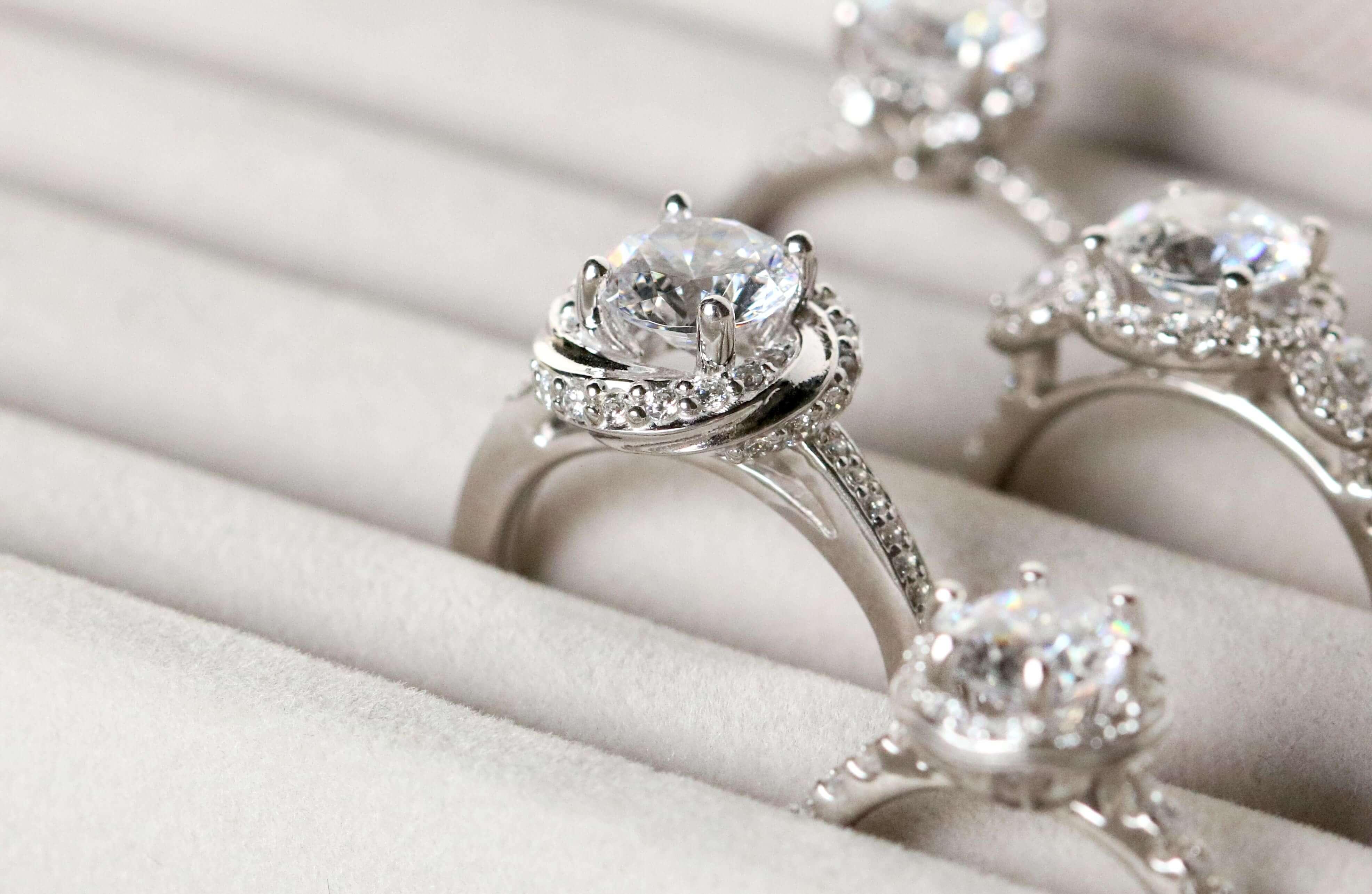 Multiple Diamond Nexus engagement rings in white gold.