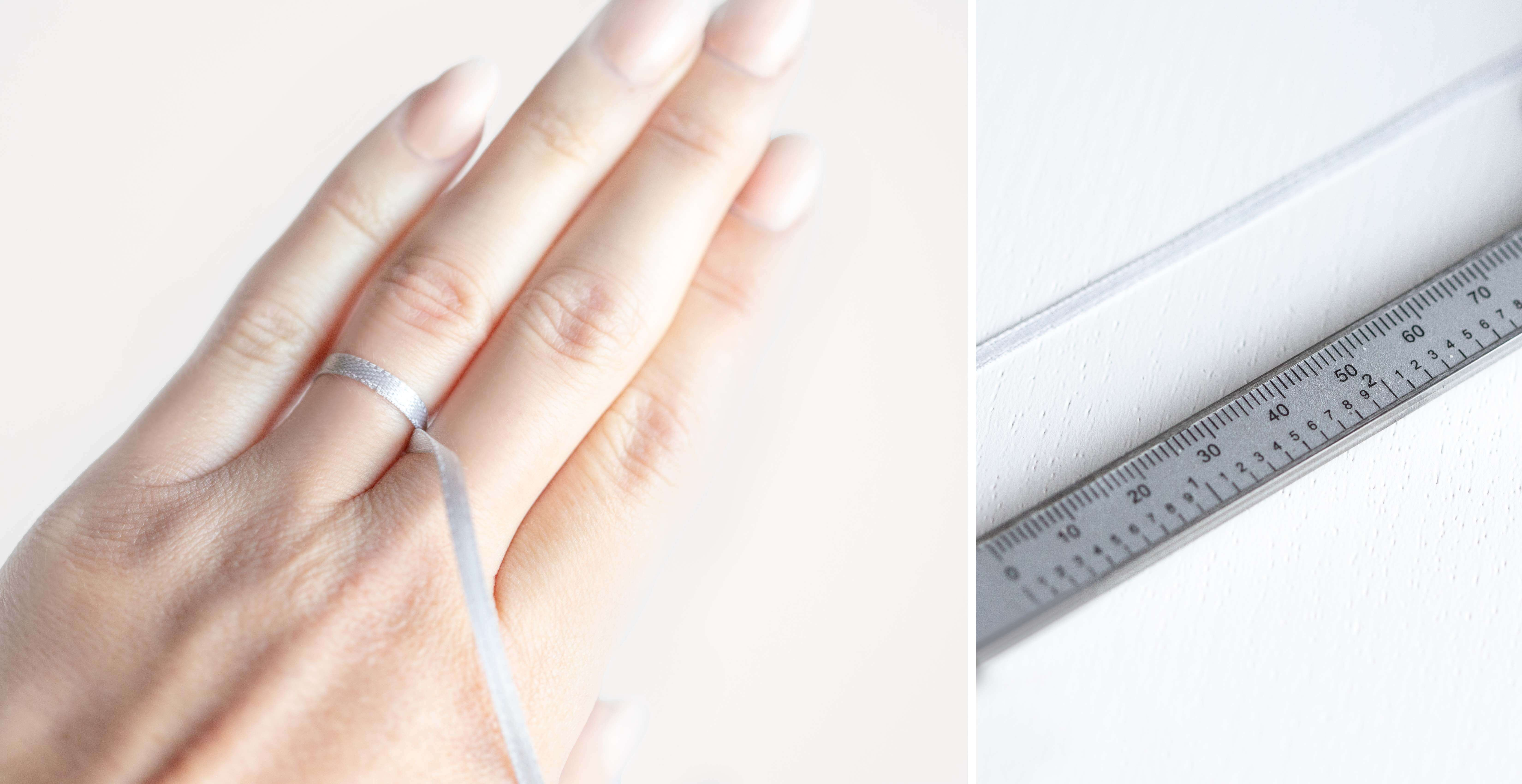 A ribbon tied around a finger and then compared next to a ruler to determine ring size.