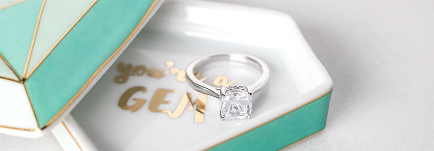 A Diamond Nexus engagement ring resting in a ring holder
