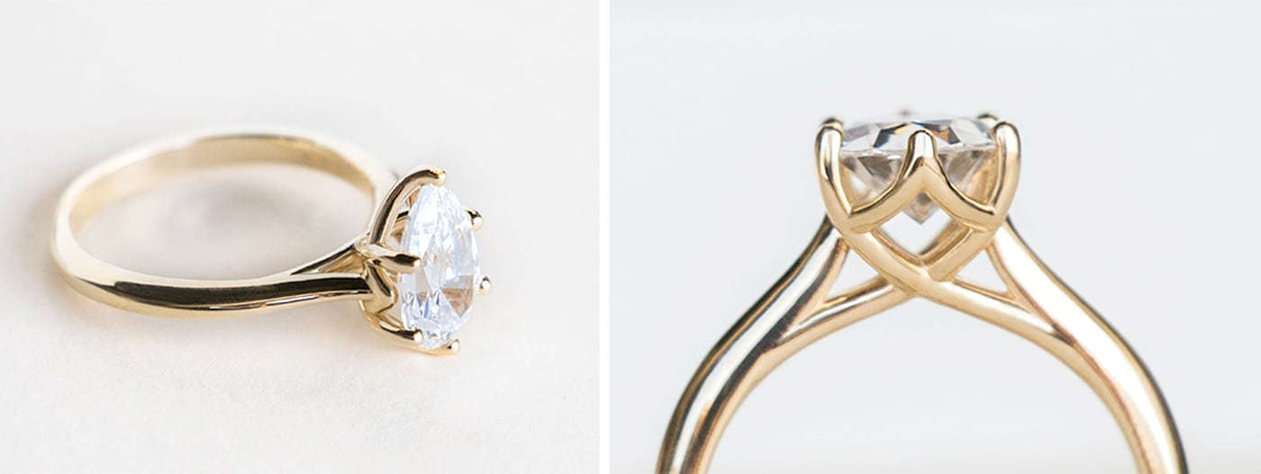 A yellow gold solitaire engagement ring in a trellis setting