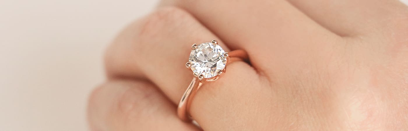 A rose gold solitaire engagement ring from Diamond Nexus