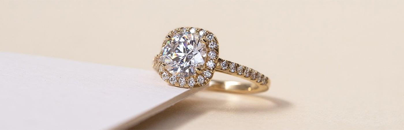 A Diamond Nexus halo engagement ring set with Nexus Diamond alternatives.