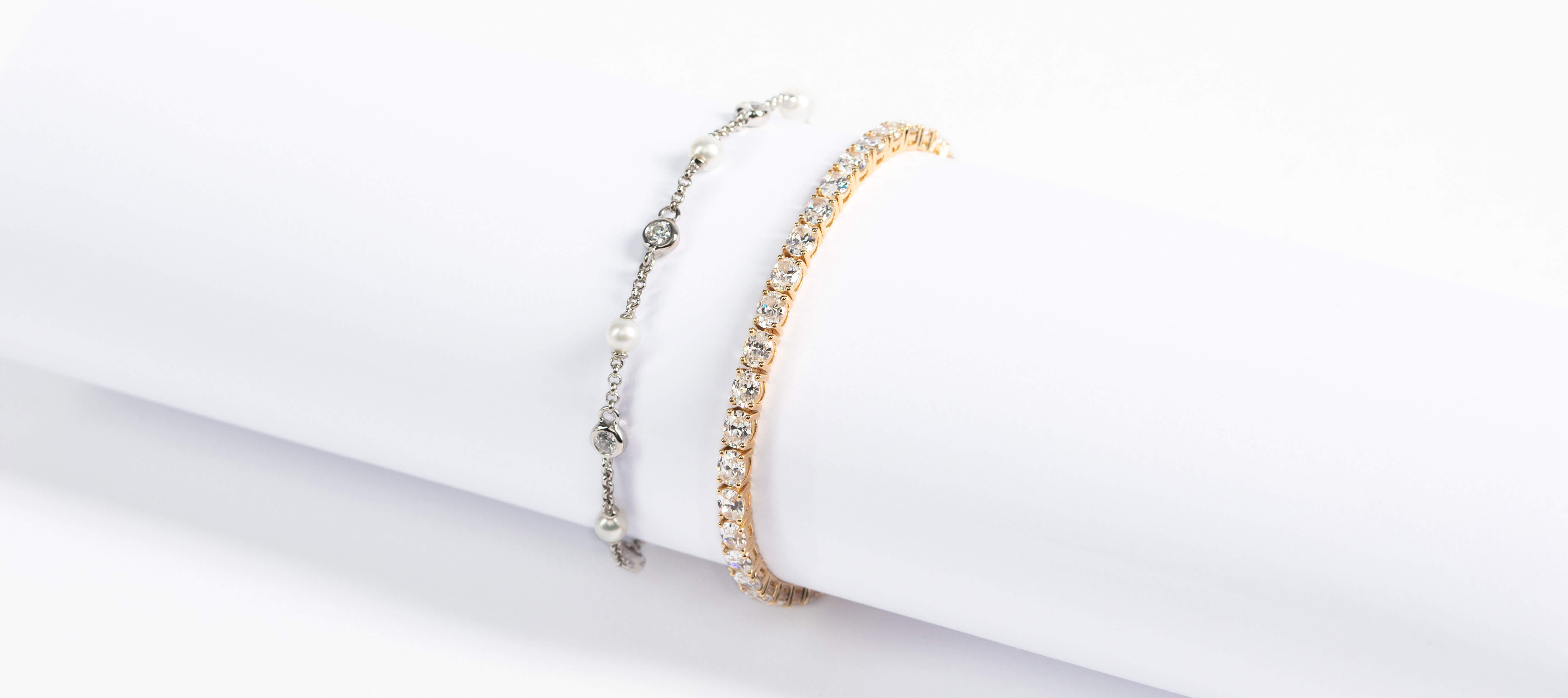 A yellow and white gold bracelet featuring Nexus Diamond alternatives.