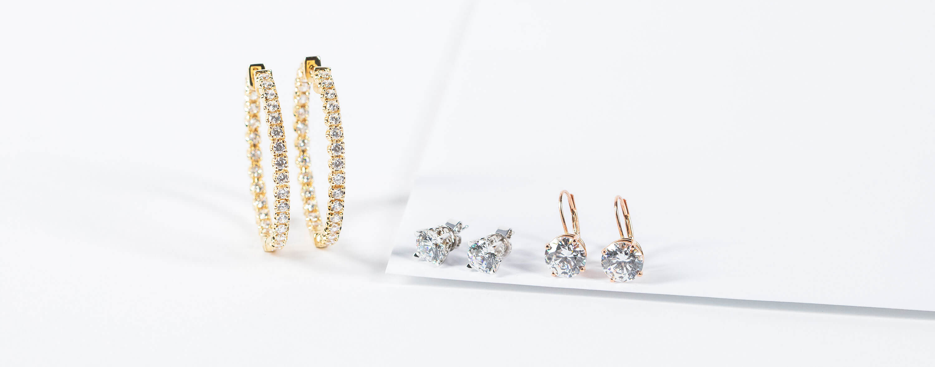 Assorted Diamond Nexus earrings in white, yellow and rose gold.