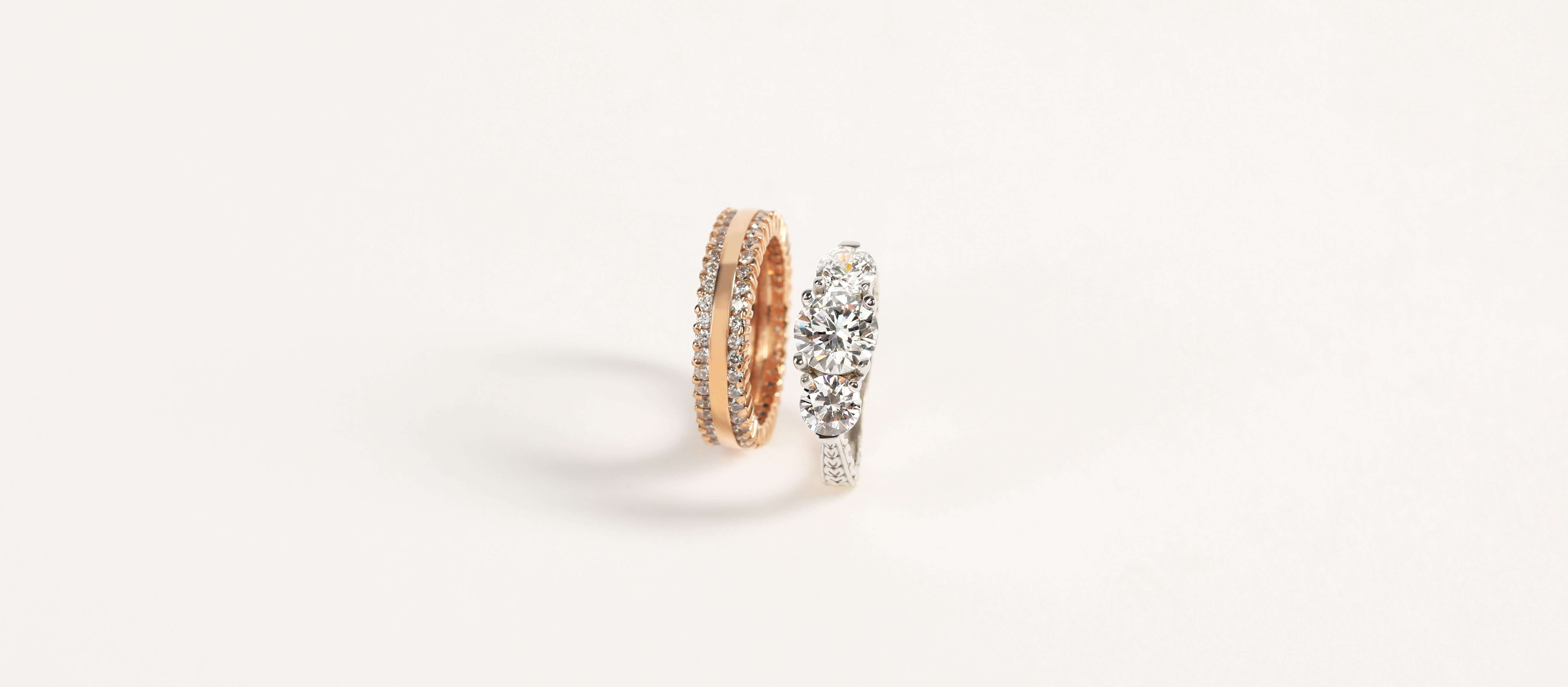 A Diamond Nexus engagement ring and wedding band in mixed metals.