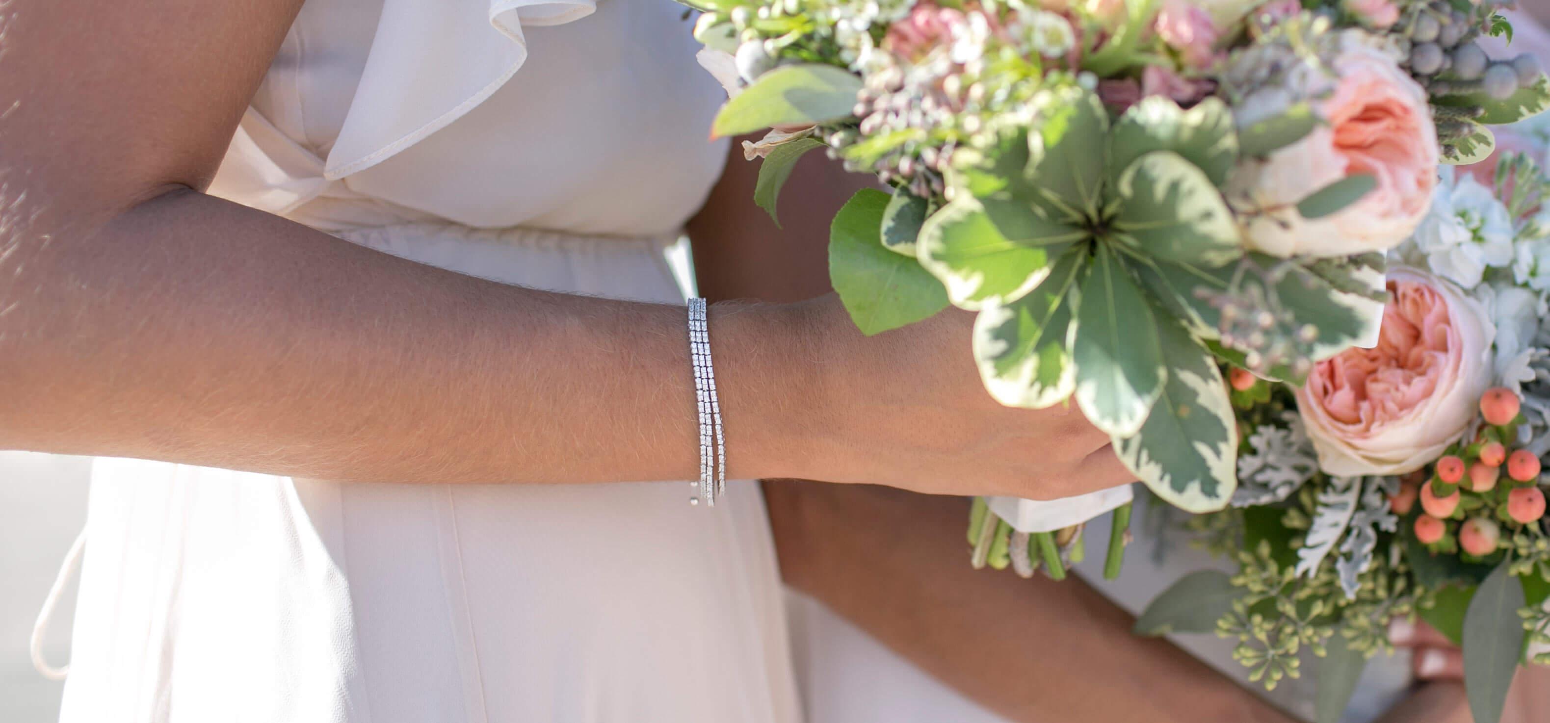 A bridesmaid wearing a Diamond Nexus bracelet stack.