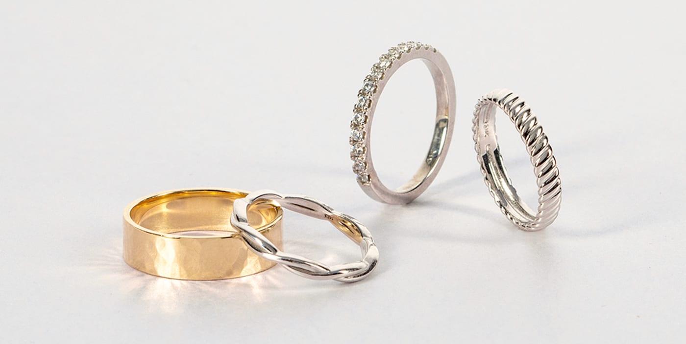 Men's & women's Diamond Nexus wedding bands.