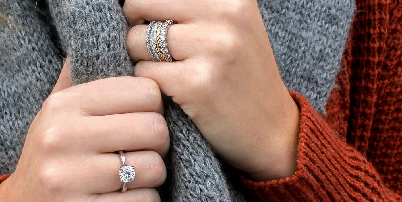 Diamond Nexus wedding ring stack and solitaire engagement ring.