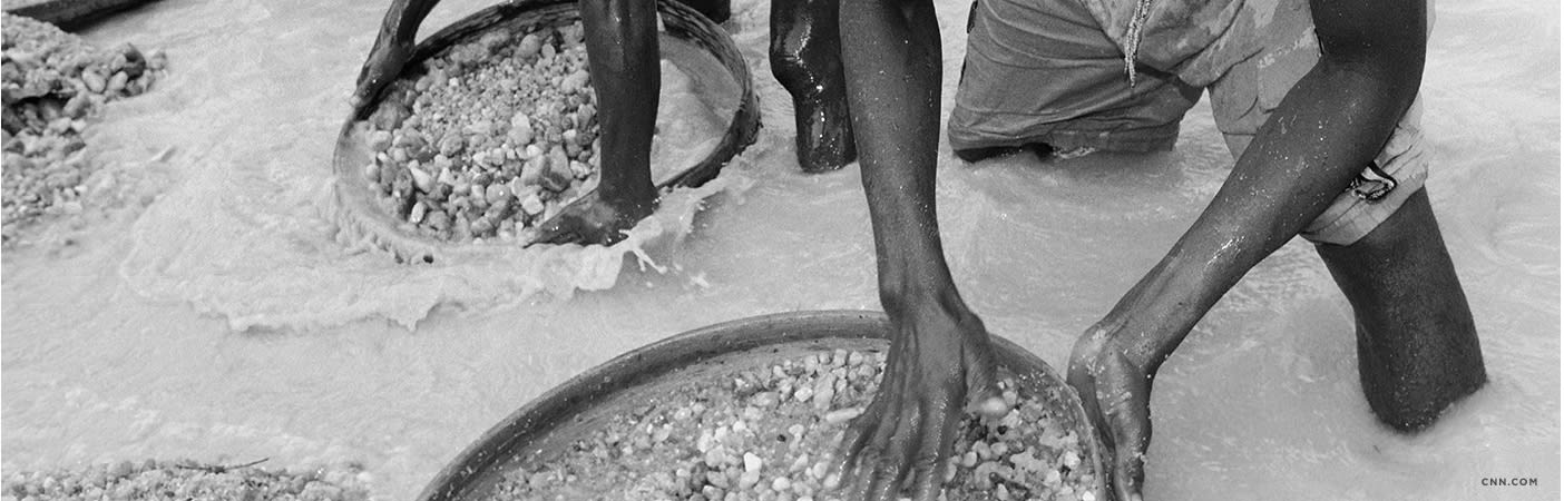 Workers sifting for diamonds.