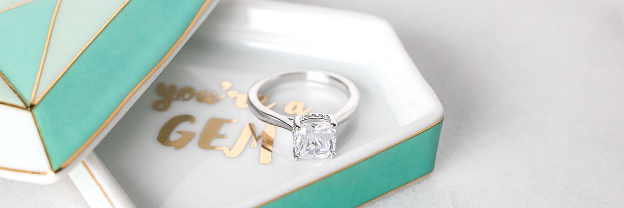A Diamond Nexus engagement ring in a ring dish.