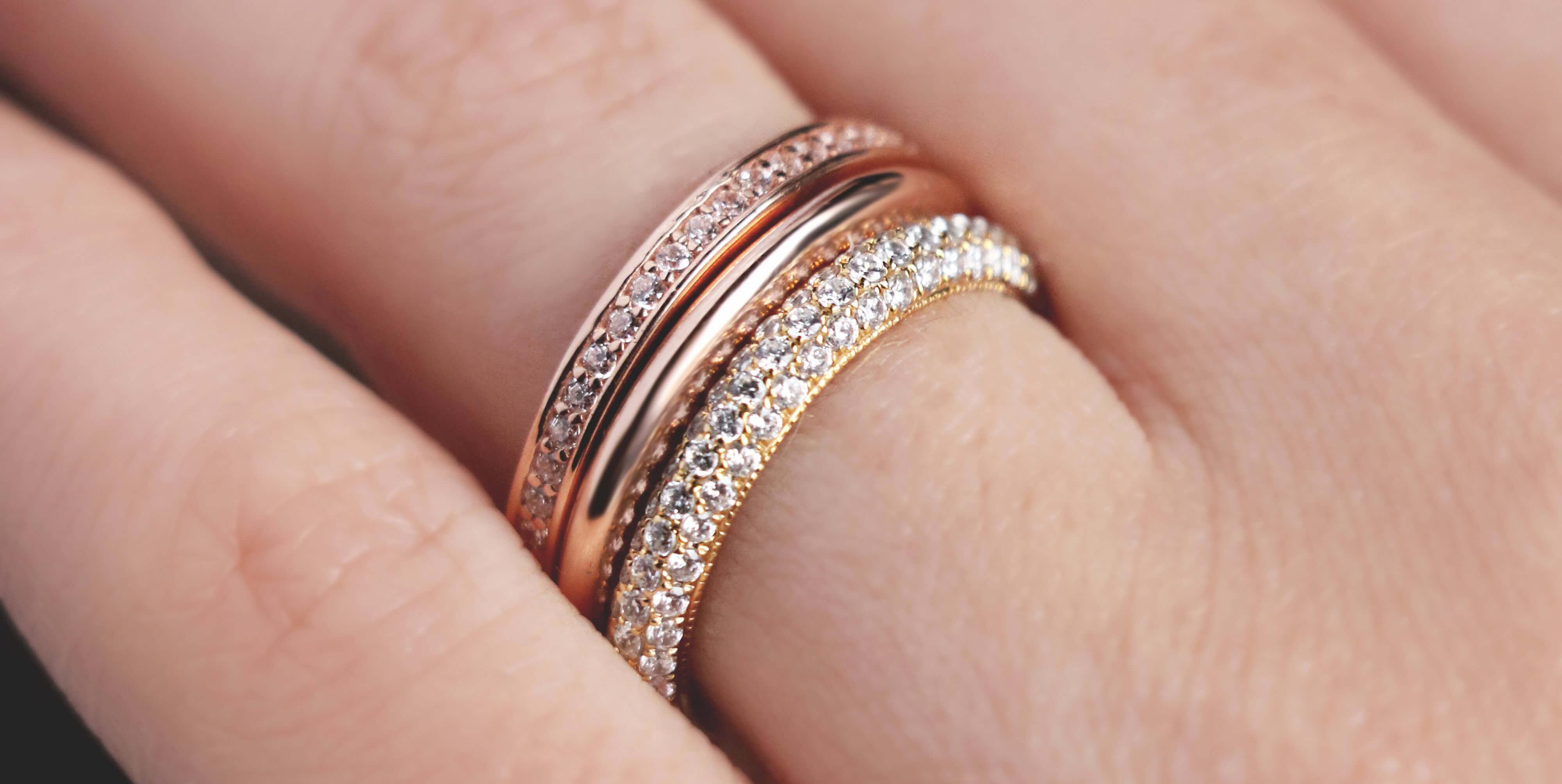A Diamond Nexus wedding band stack with mixed-metals