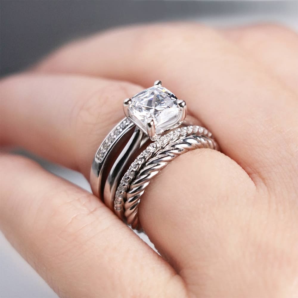 A unique white gold wedding ring stack from Diamond Nexus.
