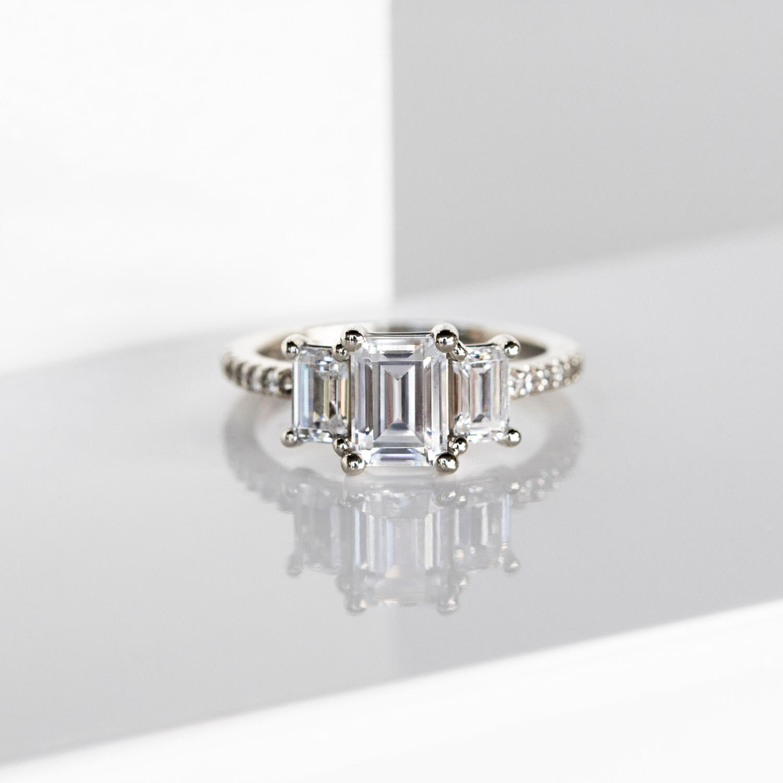 Three Stone Accented Emerald Cut