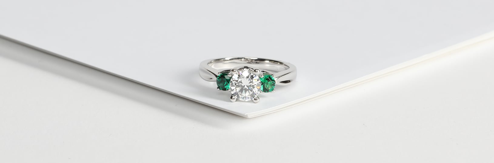 A lab created emerald engagement ring.