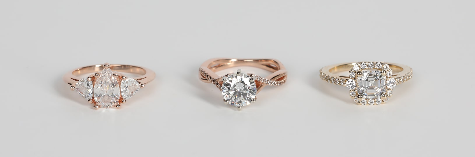 Affordable engagement rings set with lab created diamond simulants.