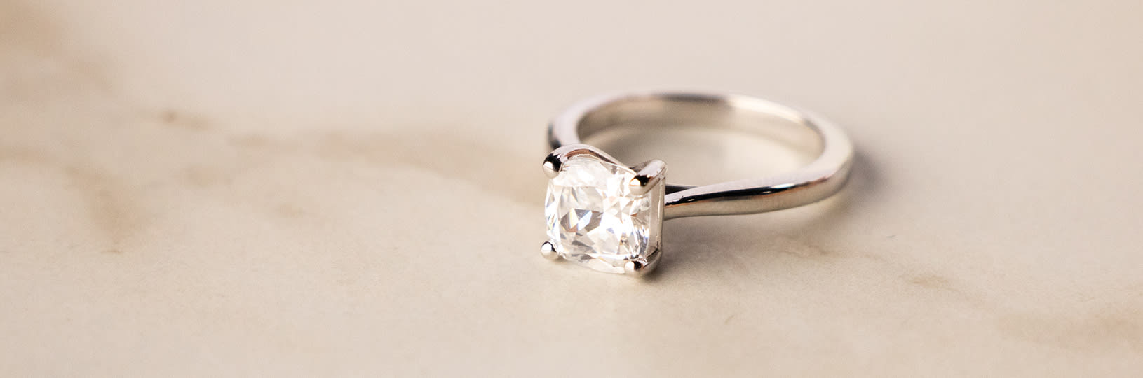 A solitaire lab created diamond simulant engagement ring.