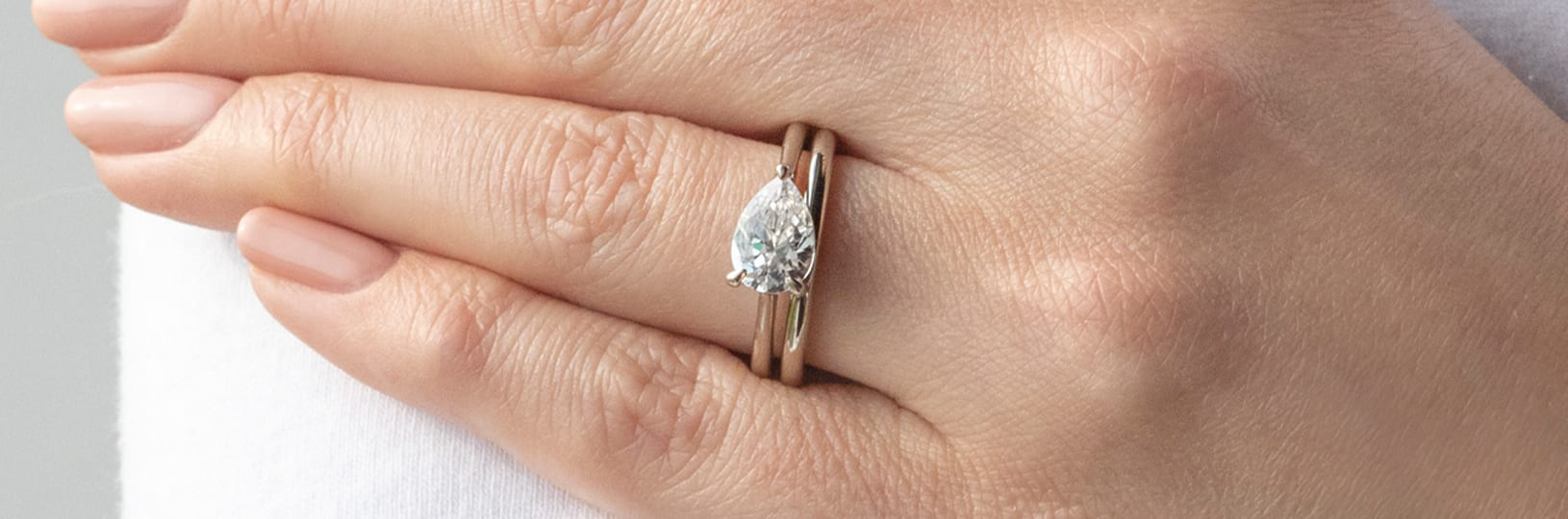 East-west solitaire engagement ring set.