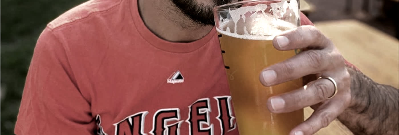 man wearing engagement ring and drinking beer