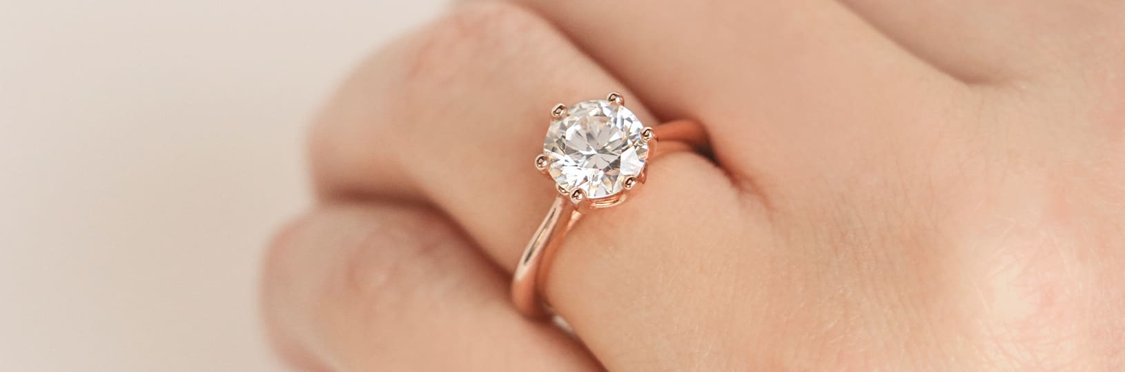 Solitaire engagement ring.