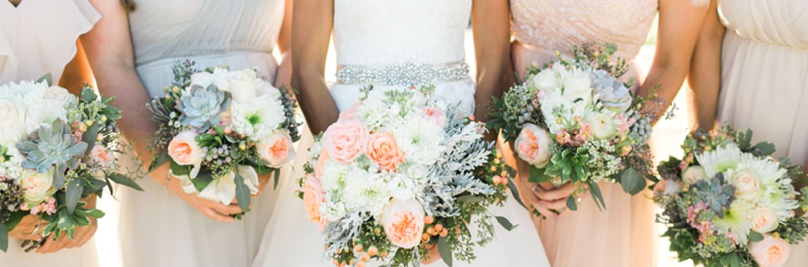 Bridesmaids wearing modern wedding jewelry.