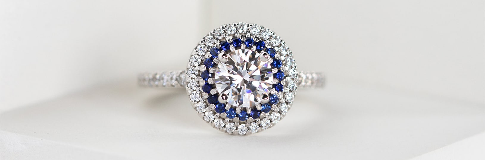 Halo sapphire engagement ring.