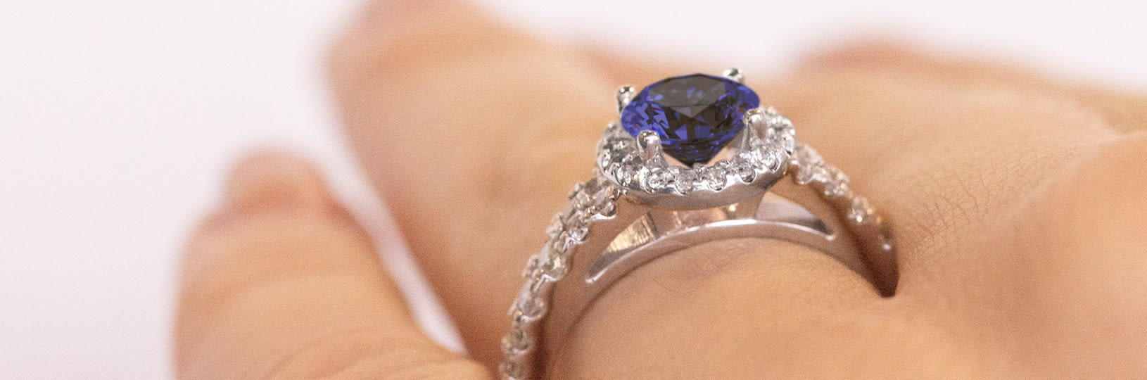 Accented sapphire engagement ring.