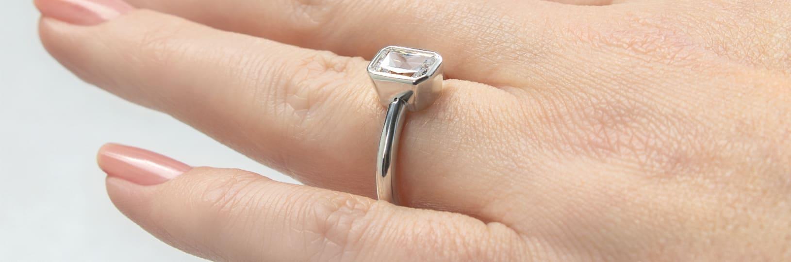 Bezel set engagement ring.